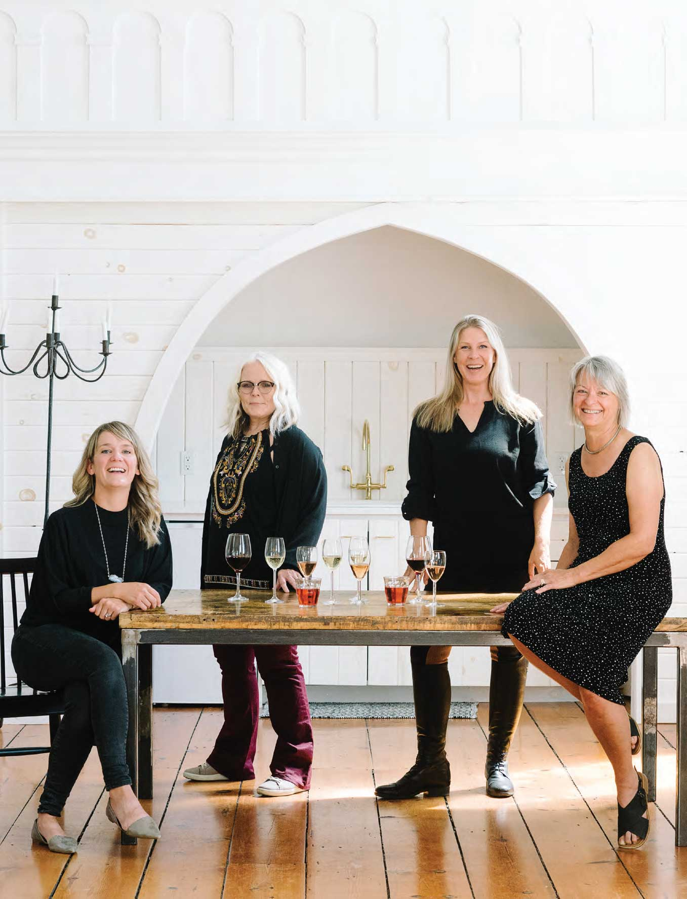 Astrid Young, Marlise Ponzo, Bev Carnahan and Sara Boyd sitting at a table drinking wine