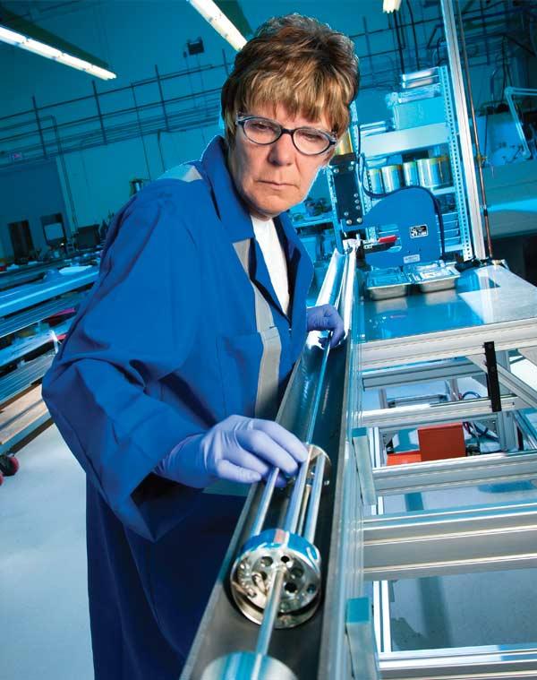 Cameco technician Brenda Sinclair assembles a cobalt adjuster set,