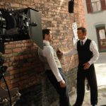 Two men talking while on set of Murdoch