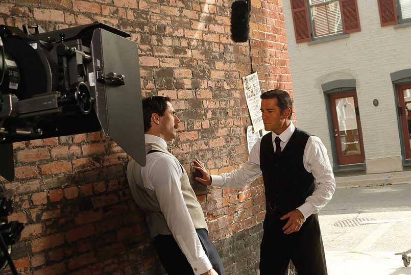 Two men talking while on set of Murdoch
